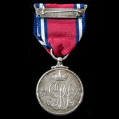 Jubilee Medal 1935, mounted on wearing pin as issued.