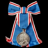 A Coronation Medal 1937, mounted on deluxe ladies issue bow ribbon.