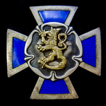 Finland - A Finnish Reserve Officers' School Badge - Two-piece construction, silver gilt and blue...
