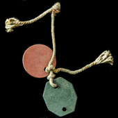 Second World War Pair of British Army identity disc with remnants of original neck cord, both sta...