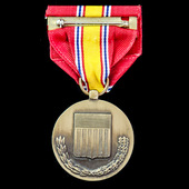 United States of America: National Defense Service Medal, mounted on a marked 'GI' crimp brooch.