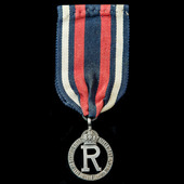 A Queen Alexandra's Imperial Military Nursing Service Reserve Cloak Badge, mounted for wear.