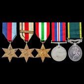 Second World War North Africa 8th Army and Italy and Territorial long service group awarded to Co...