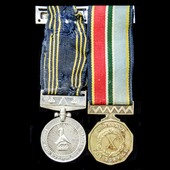   A Zimbabwe Police Long and Exemplary Service Medal and Zimbabwe 10 Year Service Medal awarded ...