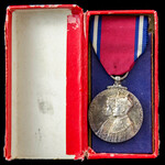 A Jubilee Medal 1935, mounted as issued on wearing pin, and housed in its original card box of is...