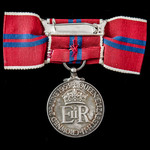 Coronation Medal 1953, complete with ladies issue bow ribbon and mounted on a pin for wear as iss...