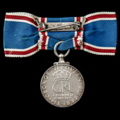 A Coronation Medal 1937, mounted on ladies issue bow ribbon.
