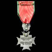 Brazil: Combat Cross, 2nd Class, in white metal, on original ribbon with safety pin device for we...