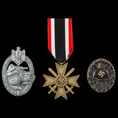 Germany – Third Reich: An Army Group South War Merit Cross 2nd Class, Tank Assault Badge in Silve...