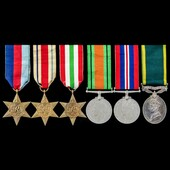 Second World War North Africa and Italy, and Territorial long service group awarded to Private J....