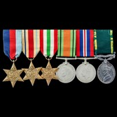 Second World War North Africa, Italy and Territorial long service group awarded to Gunner C.J. Co...