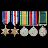 Second World War North West Europe and Territorial long service group awarded to Corporal H.J. Ha...