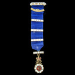 A Great War Queen Mary's Needlework Guild Membership Badge, gilt metal and enamels, with three gi...