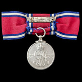 A Jubilee Medal 1935, mounted on ladies issue bow ribbon