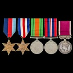Second World War North West Europe and Regular Army long service group awarded to Signalman L.G. ...