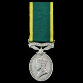 Efficiency Medal, GVI, 1st type, awarded to Corporal F.H. Hughes, Royal Welsh Fusiliers who would...