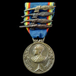 Ethiopia - Medal of the Patriot Refugees 1936-1941, with four dated palms, made by Mappin & Webb ...