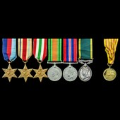 Second World War North Africa and Italy and Territorial long service group awarded to Gunner L.C....