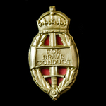 King's Commendation for Brave Conduct, 1st type plastic oval badge (1942-1945), complete with bac...