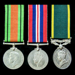 A Second World War Home Service Territorial long service group awarded to Sergeant H. Wright, Roy...
