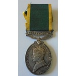 An Efficiency Medal to Private R.C. Roberts, Royal Military Police