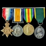Great War 1914-15 trio and Territorial Efficiency Medal group awarded to Gunner E. Harris, Royal ...