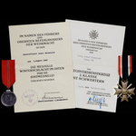 Germany - Third Reich: An interesting pair of awards and certificates to Unteroffizier Oskar Helm...