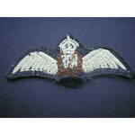Royal Air Force Pilot's Embroidered Brevet, a good example white and brown embroidery on black gr...
