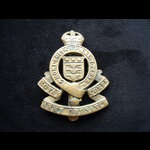 Original 'ROYAL ARMY ORDNANCE CORPS' Brass Cap Badge with King's Crown on Slider, as worn during WW2