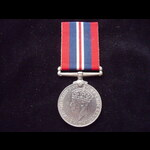 WAR MEDAL (WW2) - an officially impressed South African issue awarded to 590192 C. E. WALLACE
